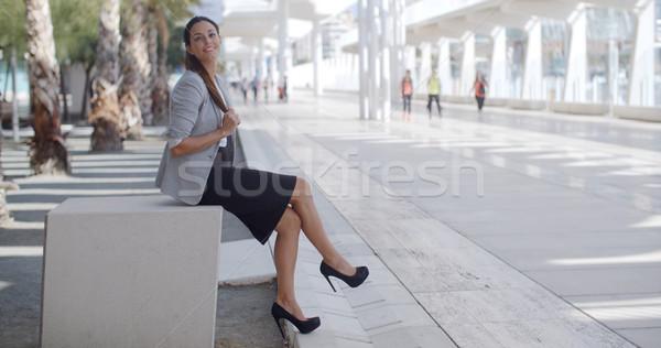 Elegáns nő ül pad promenád káprázatos Stock fotó © dash