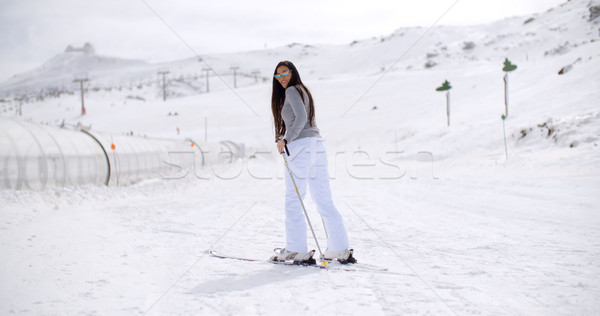 Cute woman on skis at bottom of hill Stock photo © dash