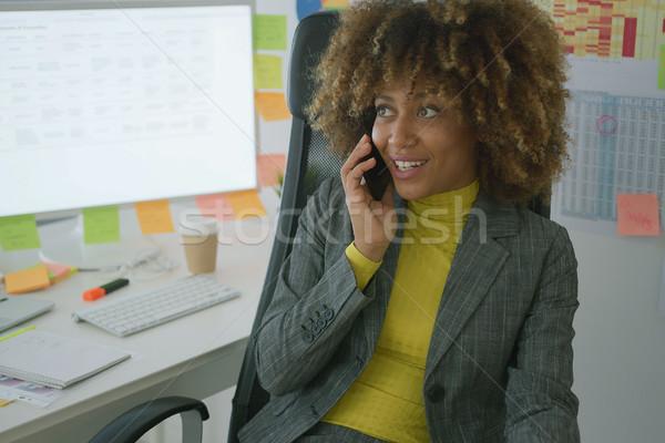 Cheerful elegant worker talking on phone Stock photo © dash