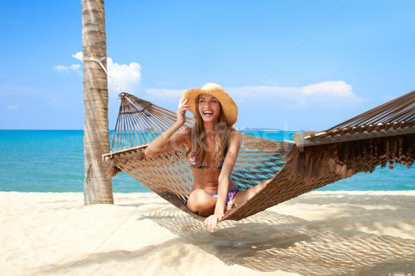 Vivacious beautiful woman in hammock Stock photo © dash