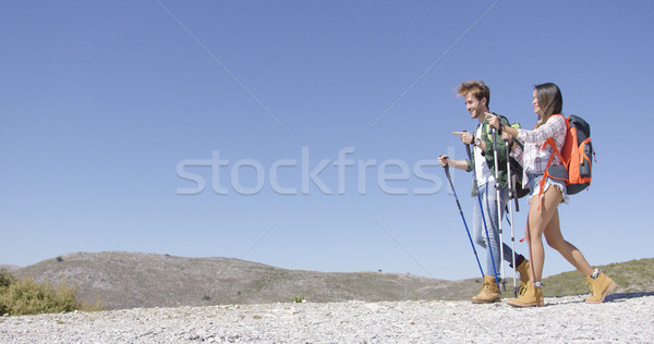 Funny couple walking with trekking poles Stock photo © dash