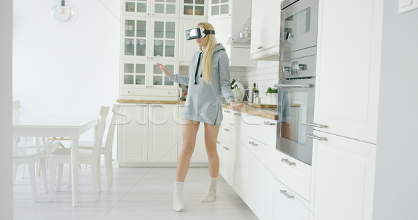 Young woman experiencing VR glasses Stock photo © dash