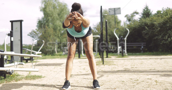 Sportswoman warming up in park Stock photo © dash