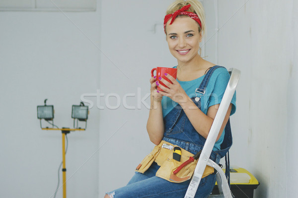 Female sitting with drink on stepladder  Stock photo © dash