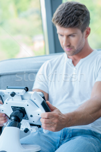 Handsome White Man Playing Games on Tablet Stock photo © dash