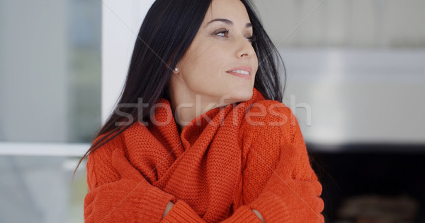Woman cuddling down in her warm winter fashion Stock photo © dash