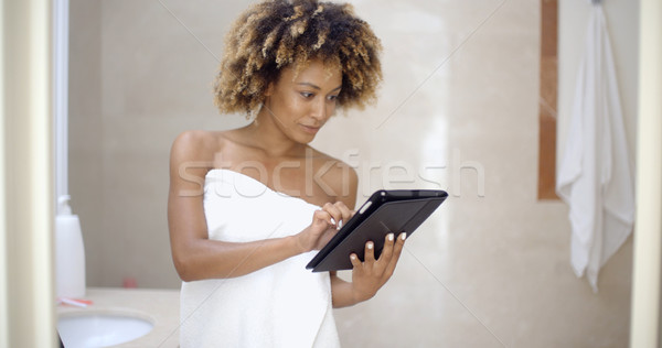 Woman Using Tablet Computer In The Bath Stock photo © dash