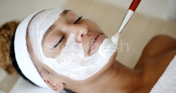 Cosmetician Applying Facial Mask Stock photo © dash