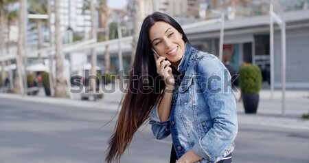 Joyful grinning woman outside in yellow scarf Stock photo © dash