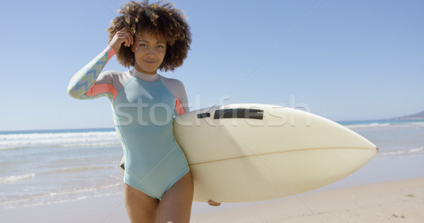 Female with surfboard posing on sea background Stock photo © dash