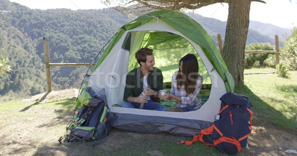 Két személy sátor fiatal nevet pár ül Stock fotó © dash