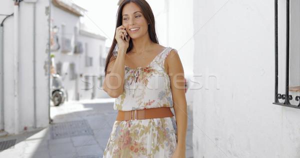Charming girl talking phone at street Stock photo © dash