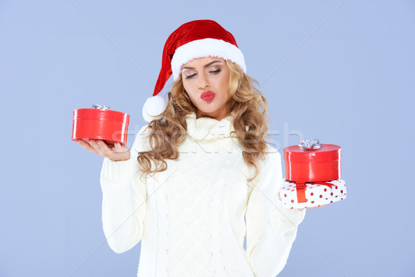 Sexy woman in Santa hat trying to decide which gift Stock photo © dash