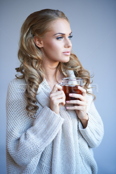Daydreaming woman drinking tea Stock photo © dash