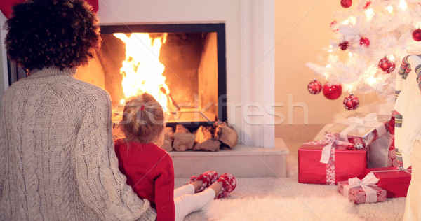 Mother and child warm up by the fireplace Stock photo © dash