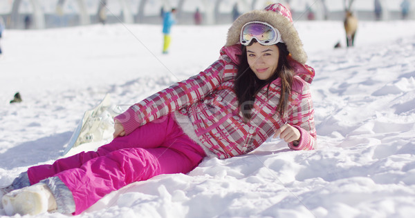 Young woman in pink snowsuit with ski goggles Stock photo © dash