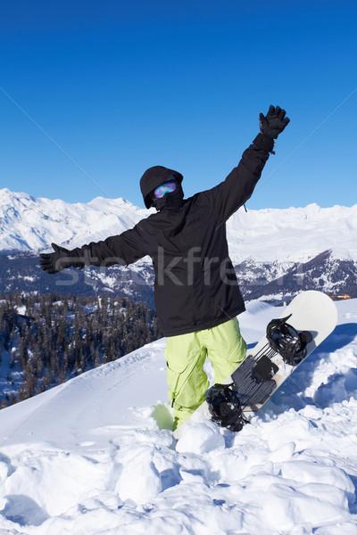 Snowboarder nero giacca posa cielo sport Foto d'archivio © dash