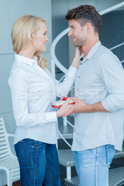 Loving wife giving her husband a Valentines gift Stock photo © dash