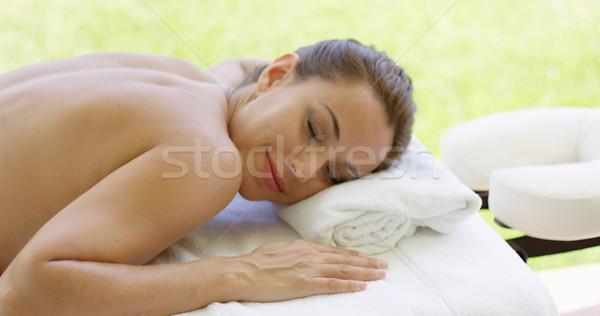Woman smiles at camera while at spa Stock photo © dash
