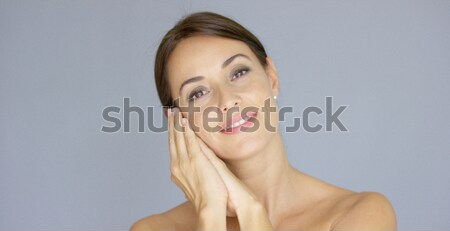 Happy young woman with hands on cheek Stock photo © dash