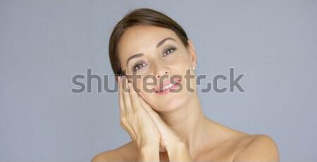 Gelukkig jonge vrouw handen wang Stockfoto © dash