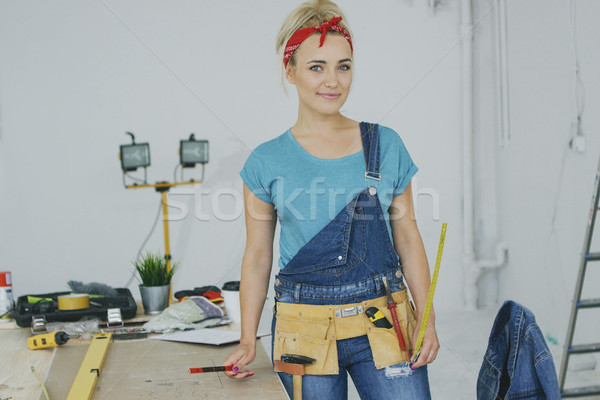 Female carpenter standing at workbench  Stock photo © dash