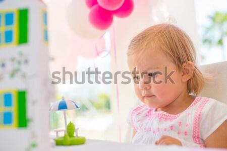 Little Girl Unpacking Her Birthday Gift Stock photo © dash