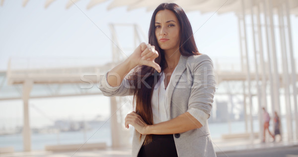 Disappointed businesswoman giving a thumbs down Stock photo © dash