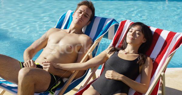 愛する 日光浴 デッキ チェア 手をつない ストックフォト © dash