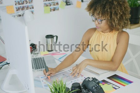 Pensive editor exploring photos Stock photo © dash