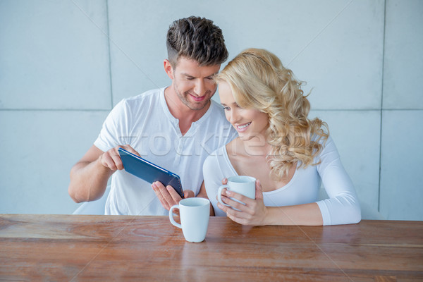 Man showing his wife something on a tablet Stock photo © dash
