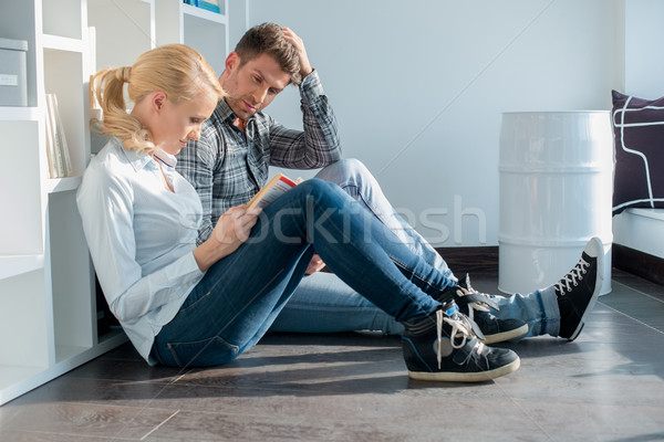 Young Partners in Casual Attire Sitting on Floor Stock photo © dash