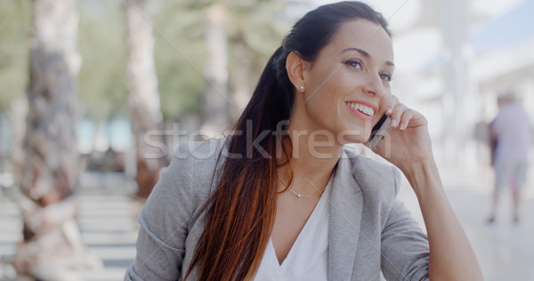 Woman leaning on a wall chatting on a mobile Stock photo © dash