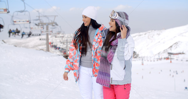 Two pretty young female friends at a ski resort Stock photo © dash