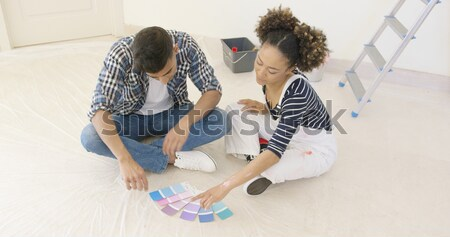 Black couple relaxes after long day of painting Stock photo © dash