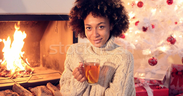 Young woman drinking spicy lemon tea Stock photo © dash