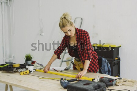 Female drilling wooden plank on workbench  Stock photo © dash