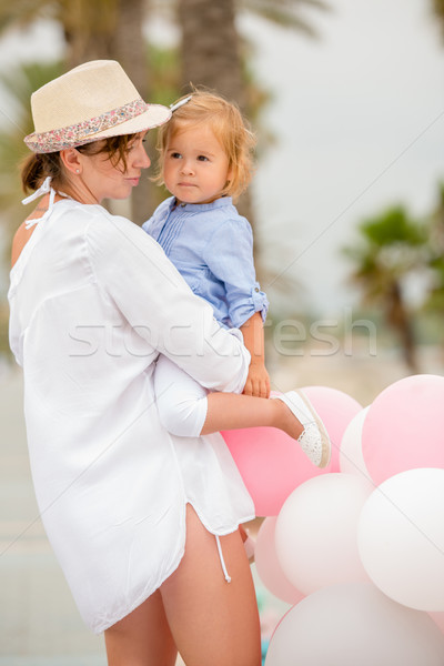Trendy mother with a baby daughter Stock photo © dash