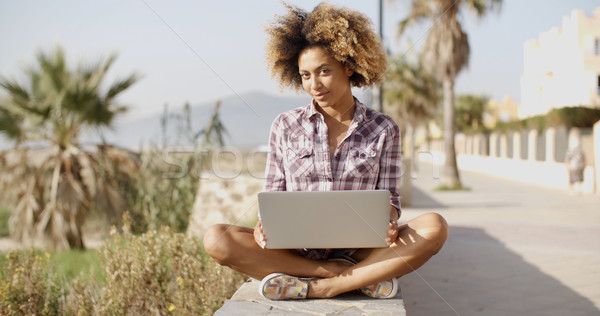 Girl Browsing A Laptop In A Bench Stock photo © dash