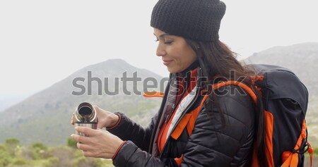 Happy smiling woman enjoying a misty hike Stock photo © dash