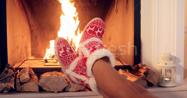 Young woman relaxing in Christmas booties Stock photo © dash