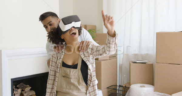 Happy young couple doing Virtual tour in new apartment Stock photo © dash