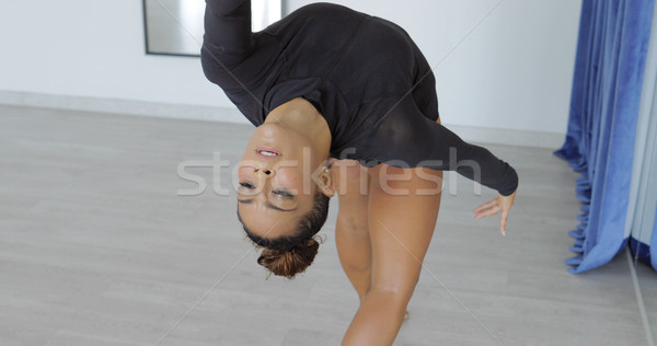 Expressive woman in motion of dance Stock photo © dash