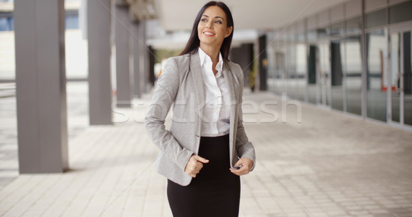 Business woman adjusting her hair outdoors Stock photo © dash