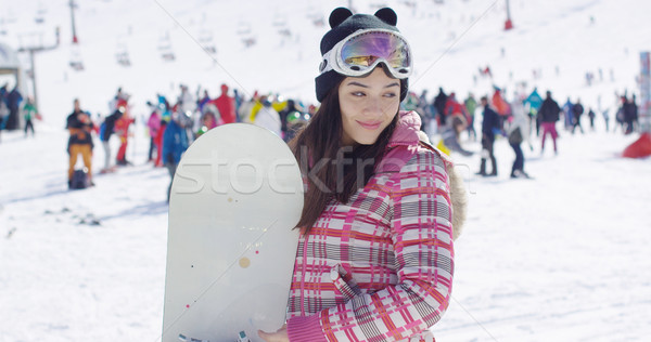 Smiling woman on ski slope with snowboard Stock photo © dash