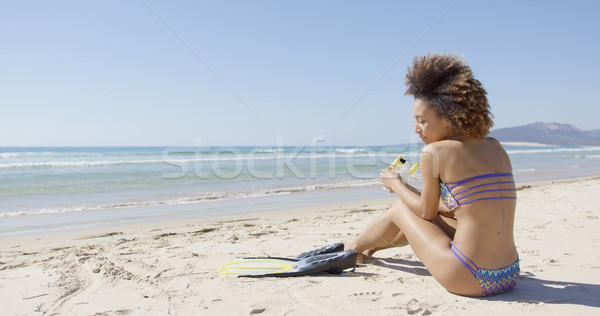 Female with flippers sitting on beach Stock photo © dash