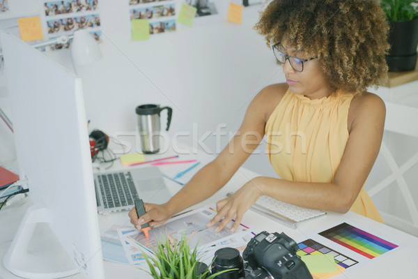 Confident woman working with photos Stock photo © dash