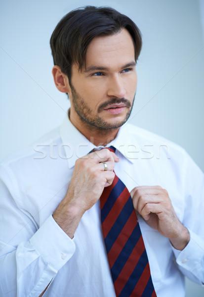 Attractive man straightening his tie Stock photo © dash