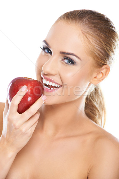 Laughing woman with a red apple Stock photo © dash