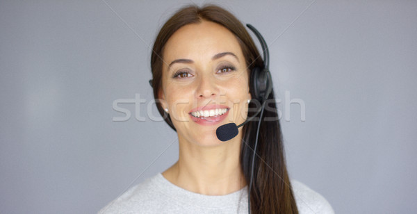 Adorable call center agent speaking with someone on headset Stock photo © dash